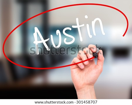 Man Hand writing Austin  with black marker on visual screen. Isolated on office. Business, technology, internet concept. Stock Photo - stock photo