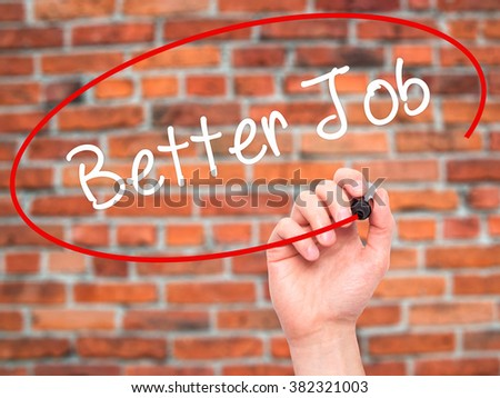 Man Hand writing Better Job with black marker on visual screen. Isolated on background. Business, technology, internet concept. Stock Photo - stock photo