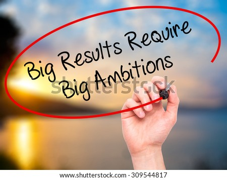 Man Hand writing Big Results Require Big Ambitions with black marker on visual screen. Isolated on nature. Business, technology, internet concept. Stock Photo - stock photo