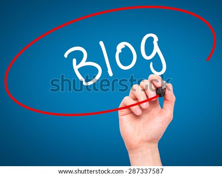 Man Hand writing Blog with marker on transparent wipe board. Isolated on blue. Business, internet, technology concept. Stock Photo - stock photo