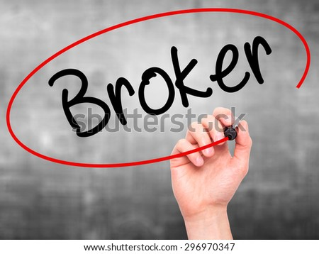 Man Hand writing Broker with black marker on visual screen. Isolated on grey. Business, technology, internet concept. Stock Photo - stock photo