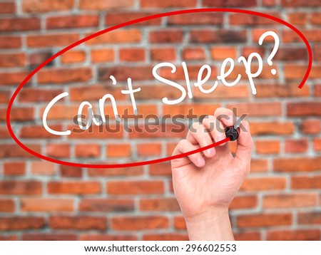 Man Hand writing Cant Sleep? with black marker on visual screen. Isolated on bricks. Business, technology, internet concept. Stock Photo - stock photo