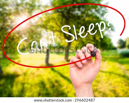 Man Hand writing Cant Sleep? with black marker on visual screen. Isolated on nature. Business, technology, internet concept. Stock Photo - stock photo