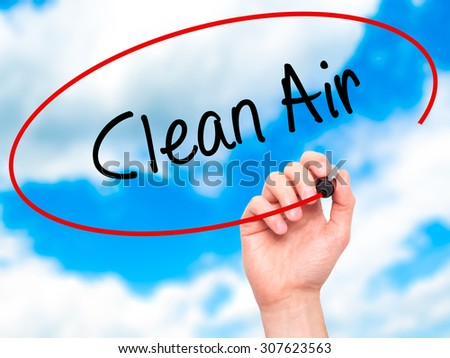 Man Hand writing Clean Air with black marker on visual screen. Isolated on sky. Business, technology, internet concept. Stock Photo - stock photo