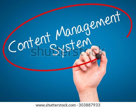 Man Hand writing Content Management System  with black marker on visual screen. Isolated on blue. Business, technology, internet concept. Stock Photo - stock photo