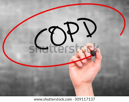 Man Hand writing COPD with black marker on visual screen. Isolated on grey. Business, technology, internet concept. Stock Photo - stock photo