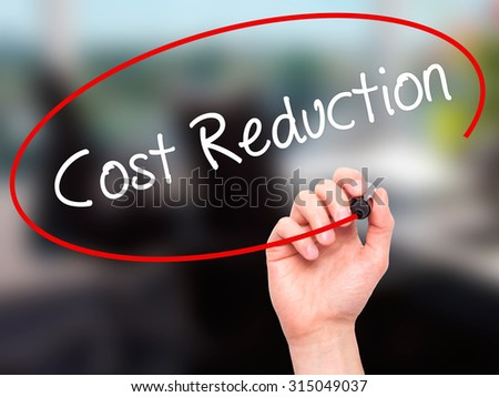 Man Hand writing Cost Reduction with black marker on visual screen. Isolated on office. Business, technology, internet concept. Stock Photo - stock photo