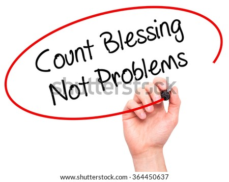 Man Hand writing Count Blessing Not Problems with black marker on visual screen. Isolated on background. Business, technology, internet concept. Stock Photo - stock photo