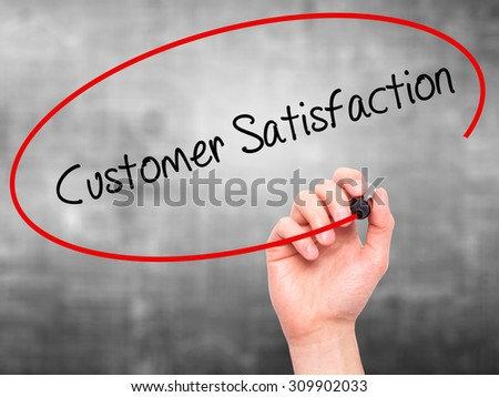 Man Hand writing Customer Satisfaction with black marker on visual screen. Isolated on grey. Business, technology, internet concept. Stock Photo - stock photo