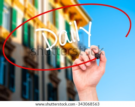 Man Hand writing Daily with black marker on visual screen. Isolated on city. Business, technology, internet concept. Stock Photo - stock photo