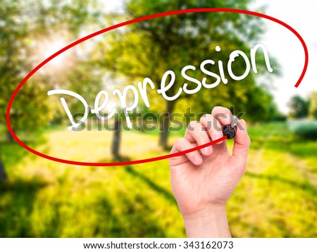 Man Hand writing Depression  with black marker on visual screen. Isolated on nature. Business, technology, internet concept. Stock Photo - stock photo