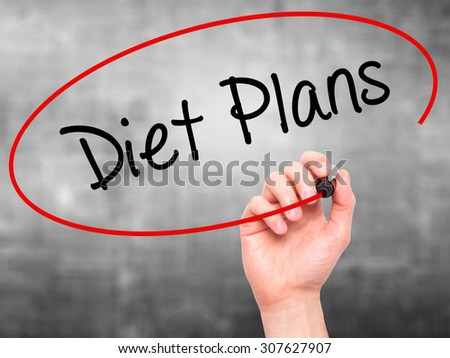 Man Hand writing  Diet Plans  with black marker on visual screen. Isolated on grey. Business, technology, internet concept. Stock Photo - stock photo