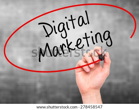 Man Hand writing Digital Marketing with marker on transparent wipe board. Isolated on grey. Business, internet, technology concept. Stock Photo - stock photo
