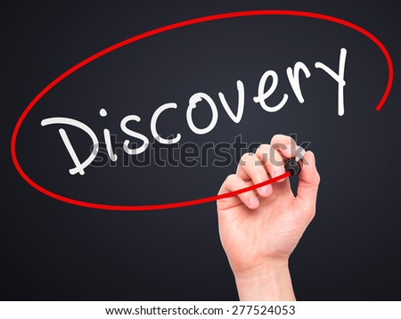 Man Hand writing Discovery with marker on transparent wipe board. Isolated on black. Business, internet, technology concept.  Stock Photo - stock photo