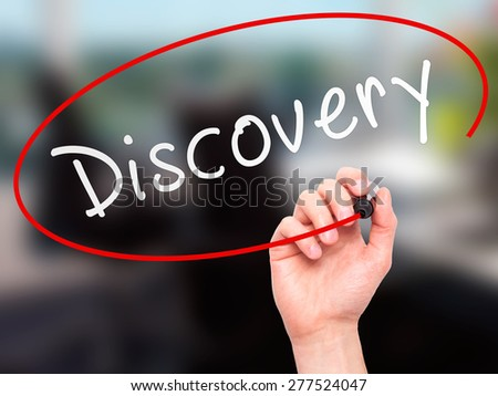 Man Hand writing Discovery with marker on transparent wipe board. Isolated on office. Business, internet, technology concept.  Stock Photo - stock photo