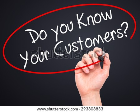 Man Hand writing Do you Know your Customers? with black marker on visual screen. Isolated on black. Business, technology, internet concept. Stock Photo - stock photo