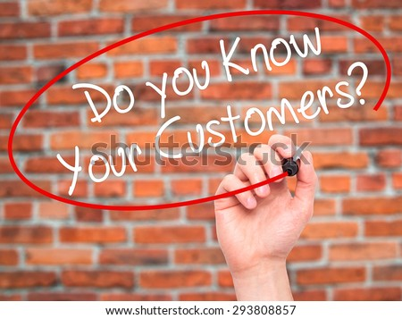 Man Hand writing Do you Know your Customers? with black marker on visual screen. Isolated on bricks. Business, technology, internet concept. Stock Photo - stock photo