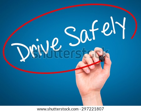 Man Hand writing  Drive Safely with black marker on visual screen. Isolated on blue. Business, technology, internet concept. Stock Photo - stock photo
