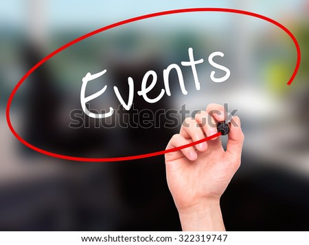 Man Hand writing Events with black marker on visual screen. Isolated on office. Business, technology, internet concept. Stock Photo - stock photo