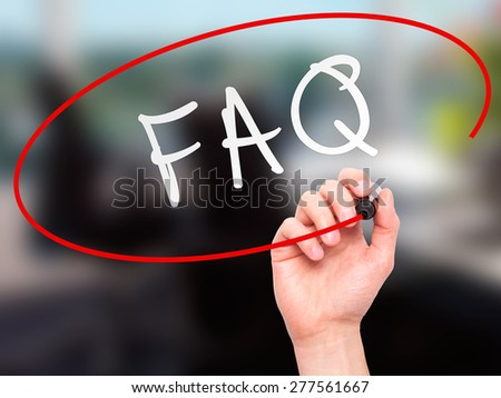Man Hand writing FAQ - Frequently Asked Questions with marker on transparent wipe board. Isolated on office. Business, internet, technology concept.  Stock Photo - stock photo