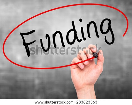 Man Hand writing Funding with marker on transparent wipe board. Isolated on grey. Business, internet, technology concept. Stock Photo - stock photo