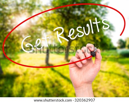 Man Hand writing Get Results with black marker on visual screen. Isolated on nature. Business, technology, internet concept. - stock photo