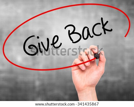 Man Hand writing Give Back with black marker on visual screen. Isolated on grey. Business, technology, internet concept. Stock Photo - stock photo