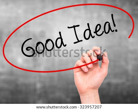 Man Hand writing Good Idea! with black marker on visual screen. Isolated on grey. Business, technology, internet concept. Stock Photo - stock photo