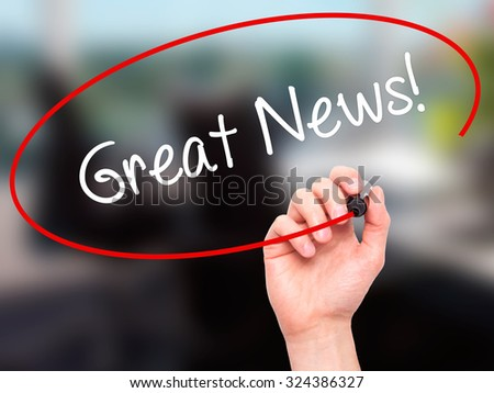 Man Hand writing Great News! with black marker on visual screen. Isolated on office. Business, technology, internet concept. Stock Photo - stock photo