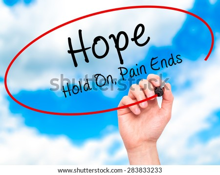 Man Hand writing Hope with marker on transparent wipe board. Isolated on sky. Business, internet, technology concept. Hold On, Pain Ends. Stock Photo - stock photo