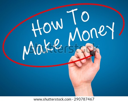 Man Hand writing How To Make Money with black marker on visual screen. Isolated on blue. Business, technology, internet concept. Stock Image - stock photo