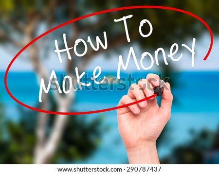 Man Hand writing How To Make Money with black marker on visual screen. Isolated on nature. Business, technology, internet concept. Stock Image - stock photo