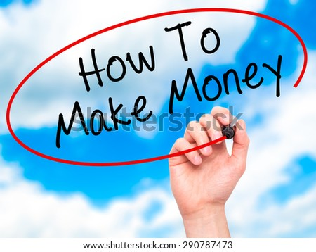 Man Hand writing How To Make Money with black marker on visual screen. Isolated on sky. Business, technology, internet concept. Stock Image - stock photo