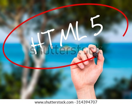 Man Hand writing HTML 5 with black marker on visual screen. Isolated on nature. Business, technology, internet concept. Stock Photo - stock photo