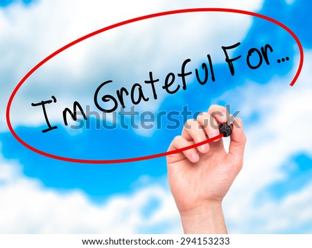 Man Hand writing I'm Grateful For... with black marker on visual screen. Isolated on sky. Business, technology, internet concept. Stock Photo - stock photo