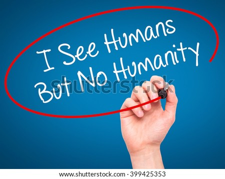 Man Hand writing I See Humans But No Humanity with black marker on visual screen. Isolated on background. Business, technology, internet concept. Stock 