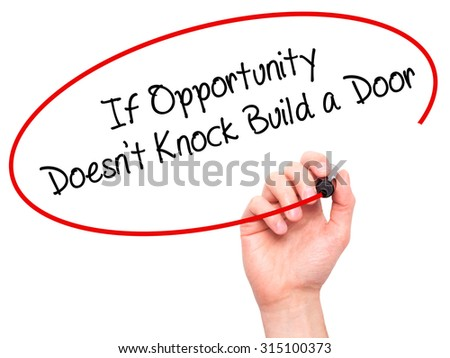 Man Hand writing If Opportunity Doesn't Knock Build a Door with black marker on visual screen. Isolated on white. Business, technology, internet concept. Stock Photo - stock photo