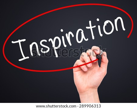 Man Hand writing Inspiration with black marker on visual screen. Isolated on black. Business, technology, internet concept. Stock Image - stock photo