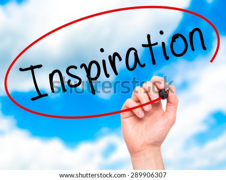 Man Hand writing Inspiration with black marker on visual screen. Isolated on sky. Business, technology, internet concept. Stock Image - stock photo