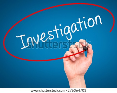 Man Hand writing Investigation with marker on transparent wipe board. Isolated on blue. Business, internet, technology concept.  Stock Photo - stock photo