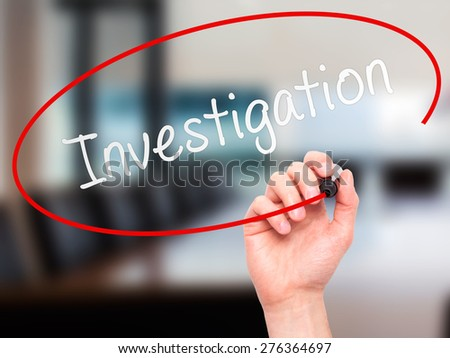 Man Hand writing Investigation with marker on transparent wipe board. Isolated on office. Business, internet, technology concept.  Stock Photo - stock photo