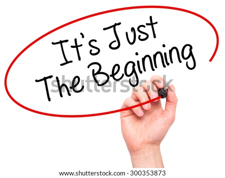Man Hand writing It's Just The Beginning with black marker on visual screen. Isolated on white. Business, technology, internet concept. Stock Photo - stock photo