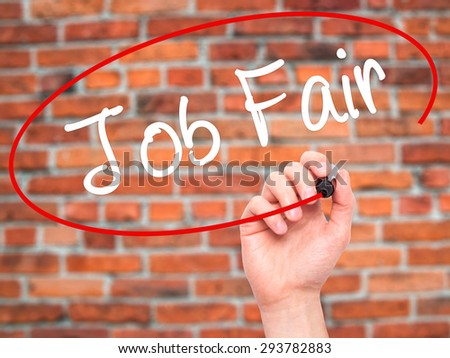 Man Hand writing Job Fair with black marker on visual screen. Isolated on bricks. Business, technology, internet concept. Stock Image - stock photo