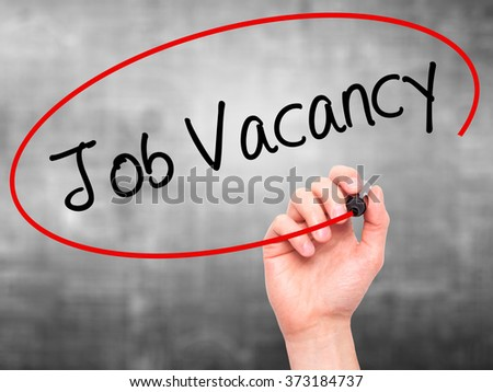 Man Hand writing Job Vacancy with black marker on visual screen. Isolated on background. Business, technology, internet concept. Stock Photo - stock photo