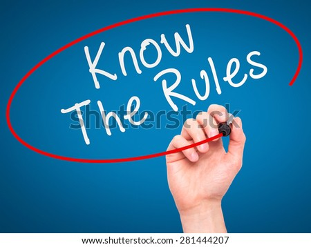 Man Hand writing Know The Rules with marker on transparent wipe board isolated on blue. Business, internet, technology concept. Stock Photo - stock photo
