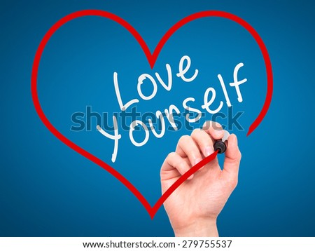 Man Hand writing Love Yourself with marker on transparent wipe board, inside heart shape. Isolated on blue. Business, internet, technology concept. Stock Photo - stock photo