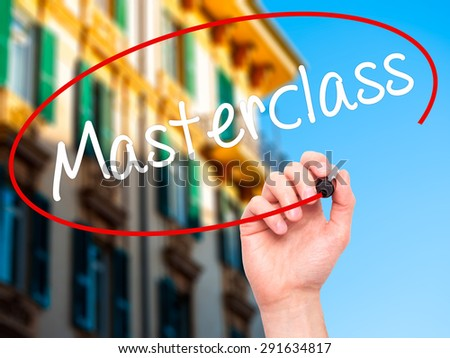 Man Hand writing Masterclass with black marker on visual screen. Isolated on city. Education technology, internet concept. Stock Image - stock photo