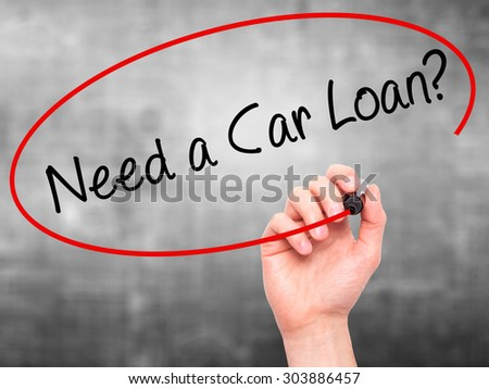 Man Hand writing Need a Car Loan? with black marker on visual screen. Isolated on grey. Business, technology, internet concept. Stock Photo - stock photo