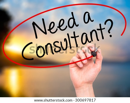 Man Hand writing Need a Consultant? with black marker on visual screen. Isolated on nature. Business, technology, internet concept. Stock Photo - stock photo