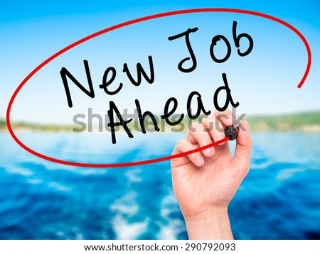 Man Hand writing New Job Ahead with black marker on visual screen. Isolated on nature. Business, technology, internet concept. Stock Image - stock photo